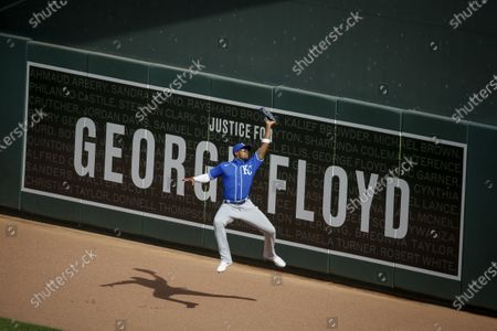 Kansas City Royals right fielder Jorge Soler catches a sacrifice fly hit by Minnesota Twins right fielder Marwin Gonzalez in the first inning of game two of a baseball double-header, in Minneapolis. Soler catches the ball in front of a sign honoring George Floyd. The Royals won 4-2