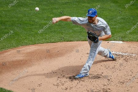 Kansas City Royals starting pitcher Ian Kennedy throws to the Minnesota Twins in the first inning of game one of a baseball double-header, in Minneapolis. The Twins won 4-2