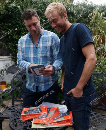 Stock Image of Nicky, left, and his brother Sam Woolf talk about their project Books for Dad, with some of the audio devices at their home in London, . Geoff Woolf gave his sons a love for literature. When he got sick with COVID-19, they turned to books to help him - and others. The 73-year-old retired lawyer was hospitalized in London in March, and within days he was on a ventilator in intensive care. Then sons Nicky, a 33-year-old journalist, and Sam, a 28-year-old actor, had an idea: Maybe literature could help him and other patients