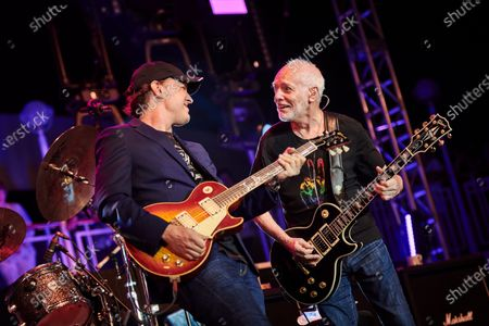 Guitarists Joe Bonamassa (L) and Peter Frampton performing live on stage during the Keeping The Blues Alive At Sea event on board the Norwegian Pearl cruise ship in the Mediterranean, on August 18, 2019. (Photo by Joby Sessions/Guitarist Magazine)