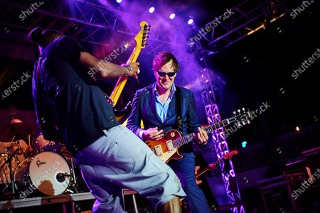 Stock Photo of American blues rock guitarists Joe Bonamassa (R) and Eric Gales performing live on stage during the Keeping The Blues Alive At Sea event on board the Norwegian Pearl cruise ship in the Mediterranean, on August 19, 2019. (Photo by Joby Sessions/Guitarist Magazine)