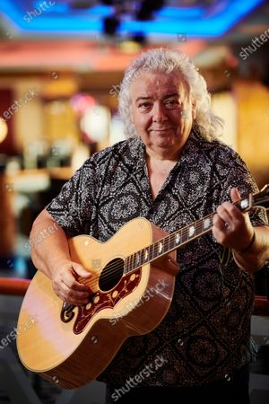 Stock Photo of Portrait of English rock guitarist Bernie Marsden, photographed during the Keeping The Blues Alive At Sea event on board the Norwegian Pearl cruise ship in the Mediterranean, on August 19, 2019. (Photo by Joby Sessions/Guitarist Magazine)