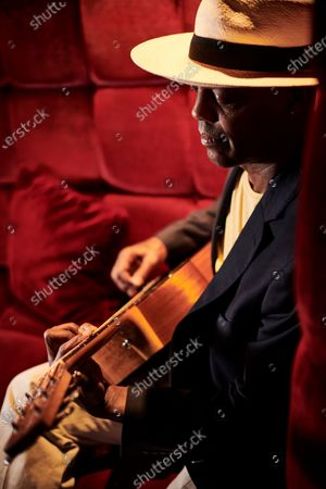 Stock Picture of Portrait of American blues guitarist Eric Bibb, photographed during the Keeping The Blues Alive At Sea event on board the Norwegian Pearl cruise ship in the Mediterranean, on August 17, 2019. (Photo by Joby Sessions/Guitarist Magazine)
