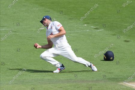 Stock Picture of Wicket - Sir Alistair Cook catches Aaron Thomason of Sussex off the bowling of Simon Harmer during the Bob Willis Trophy match between Sussex County Cricket Club and Essex County Cricket Club at the 1st Central County Ground, Hove