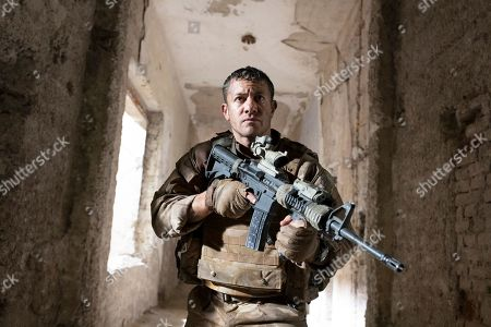 Stock Image of Warren Brown as Sgt. Thomas 'Mac' McAllister