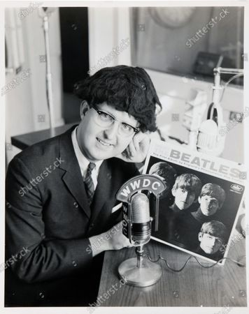 Carroll James poses with a 'mop top' wig.   A letter from George Harrison's sister thanking the DJ who 'broke' The Beatles in America has sold for £14,000.   Louise Harrison Caldwell praised provincial radio presenter Carroll James for having the 'wisdom and initiative' to play The Beatles' single 'I Want to Hold Your Hand' in November 1963.  James had played it at the request of 15-year-old listen Marsha Albert who had written to him asking after the 'new band from England'.  His airing of the record prompted a surge of interest which led to John, Paul, George and Ringo visiting America weeks later and appearing on the Ed Sullivan TV show.