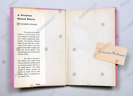 """The first edition of 'A Streetcar Named Desire' with a slip of paper signed by Tennessee Williams.   A rare first edition book which is inscribed by Hollywood legend Marlon Brando has emerged for sale for £15,000.  The Godfather actor wrote a personal message on the title page of the copy of Tennessee Williams' 'A Streetcar Named Desire' in 1947. He was starring in the play on Broadway at the time.  Brando, who was still relatively unknown, penned some sweet words to 'Carol', the daughter of fellow cast member Peg Hillias.  It was given to her as a 16th birthday present and Brando wrote: """"To Carol, with warm affection, Marlon Brando. """"  The book, which was signed by the majority of the cast, is now being sold by London-based book dealer Peter Harrington."""