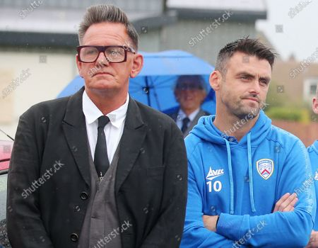 The father of actor James Nesbitt and Coleraine FC supporter passed away last week aged 91. Former radio presenter Alan Simpspon(left) and Coleraine FC Eoin Bradley pictured during the funeral as prayers are said outside the family home.