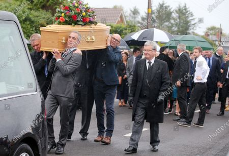 Stock Photo of The father of actor James Nesbitt and Coleraine FC supporter passed away last week aged 91. TV and film star James Nesbitt carrying his father's coffin after prayers outside the family home.