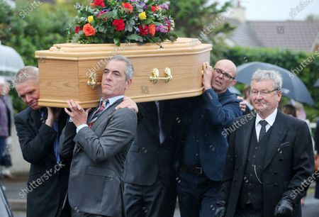 Stock Image of The father of actor James Nesbitt and Coleraine FC supporter passed away last week aged 91. TV and film star James Nesbitt carrying his father's coffin after prayers outside the family home.