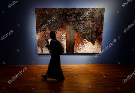 Stock Photo of Visitor examines an art work of famous Austrian avant-garde artist who works in experimental and multimedia modes, Hermann Nitsch during presentation of his paintings in the Russian Tretyakov Gallery in Moscow, Russia, 17 August 2020. The State Tretyakov Gallery accepted from the famous Austrian artist Hermann Nitsch three large-format paintings which will be included in the permanent exhibition of the New Tretyakov Gallery.