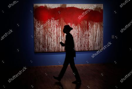 Stock Picture of A visitor examines an art work of famous Austrian avant-garde artist who works in experimental and multimedia modes, Hermann Nitsch during presentation of his paintings in the Russian Tretyakov Gallery in Moscow, Russia, 17 August 2020. The State Tretyakov Gallery accepted from the famous Austrian artist Hermann Nitsch three large-format paintings which will be included in the permanent exhibition of the New Tretyakov Gallery.