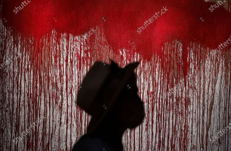 A visitor examines an art work of famous Austrian avant-garde artist who works in experimental and multimedia modes, Hermann Nitsch during presentation of his paintings in the Russian Tretyakov Gallery in Moscow, Russia, 17 August 2020. The State Tretyakov Gallery accepted from the famous Austrian artist Hermann Nitsch three large-format paintings which will be included in the permanent exhibition of the New Tretyakov Gallery.