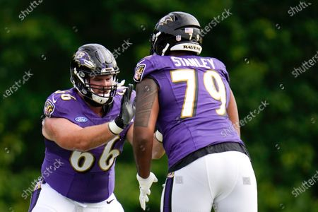 Baltimore Ravens guard Will Holden (66) works out with offensive tackle Ronnie Stanley (79) during an NFL football camp practice, in Owings Mills, Md