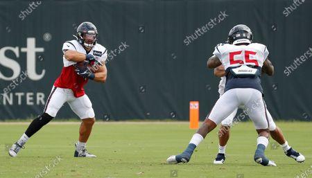Houston Texans linebacker Dylan Cole, left, runs a drill against linebacker Benardrick McKinney (55) during an NFL training camp football practice, in Houston
