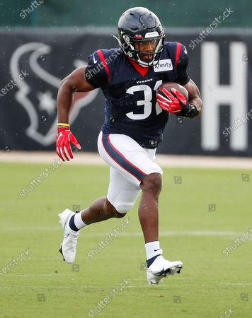 Houston Texans running back David Johnson runs with the ball during an NFL training camp football practice, in Houston