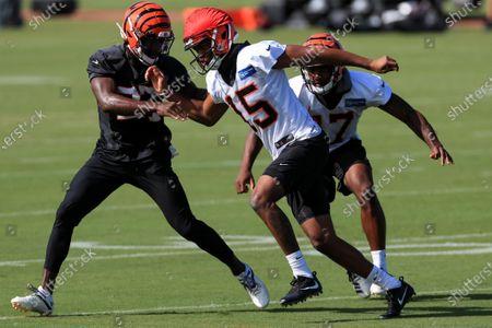 Cincinnati Bengals' Tony Brown (27) defends as Damion Willis (15) runs a drill against Stanley Morgan (17) during an NFL football camp practice in Cincinnati