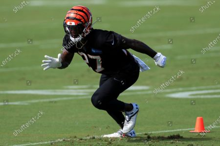Cincinnati Bengals' Tony Brown (27) runs a drill during an NFL football camp practice in Cincinnati