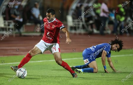 Al-Ahly player Ahmed Fathi (L) in action against Aswan player Ahmed Amer (R) during the Egyptian Premier League soccer match between Al-Ahly and Aswan, in Cairo, Egypt, 17 August 2020.