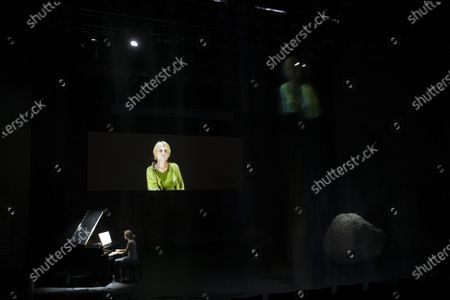 Ursina Lardi performs next to a screen showing Helga Bedau during a rehearsal of the drama 'Everywoman' in Salzburg, Austria, 17 August 2020. Milo Rau's drama production will be staged at the Salzburg Festival, which runs from 01 to 30 August 2020.