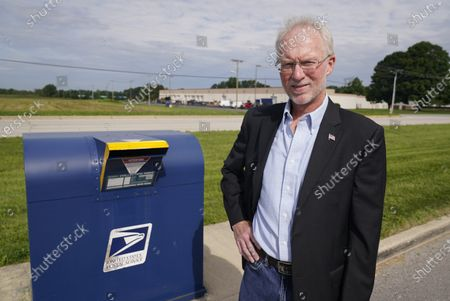 Stock Image of Doug Brown, postal staffer and president of the American Postal Workers Union chapter in Indiana, poses for a picture outside of a post office facility, in Muncie, Ind. The U.S. Postal Service is expected to play a central role in this year's presidential elections with so many states promoting voting by mail amid the coronavirus pandemic