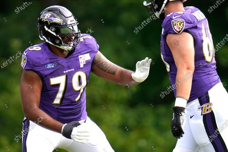 Baltimore Ravens offensive tackle Ronnie Stanley works out during an NFL football camp practice, in Owings Mills, Md