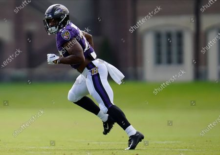 Baltimore Ravens 2020 second round draft selection running back J.K. Dobbins works out during an NFL football camp practice, in Owings Mills, Md