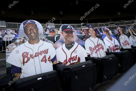 Cutouts of former Atlanta Braves players from left to right, Hank Aaron, Chipper Jones, Tommy Glavine, Greg Madduz, John Smoltz and Dale Murphy fill seats before a baseball game between the Braves and the Washington Nationals, in Atlanta, Ga