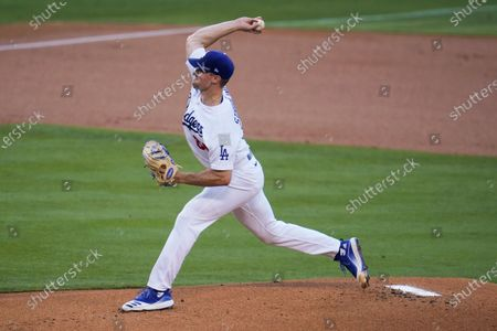 Los Angeles Dodgers starting pitcher Ross Stripling throws to the Seattle Mariners during the first inning of a baseball game, in Los Angeles