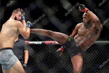 File0-Dominick Reyes, left, and Jon Jones, right, during a light heavyweight mixed martial arts bout at UFC 247, in Houston. The long-reigning UFC light heavyweight champion, Jones says he is vacating his title and likely moving up to heavyweight. Jones made the declarations on Twitter on Monday, Aug. 17, 2020, although the UFC didn't immediately confirm them