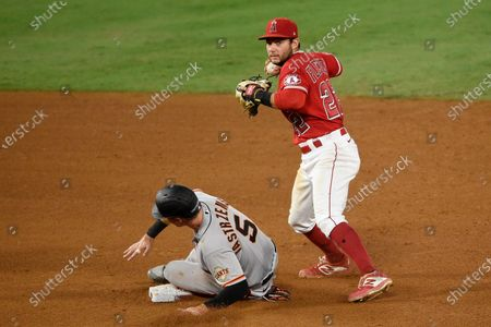 Los Angeles Angels shortstop David Fletcher, right, forces out San Francisco Giants' Mike Yastrzemski off an RBI into fielder's choice by Alex Dickerson during the fifth inning of a baseball game in Anaheim, Calif