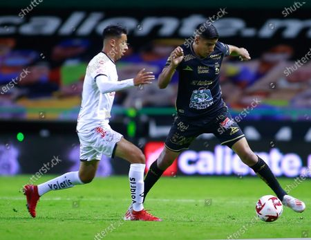Stock Picture of Armando Leon (R) of Leon in action against Christian Rivera (L) of Tijuana, during the 2020 Guardians of Mexico soccer tournament between Leon and Tijuana in Leon, Guanajuato, Mexico, 17 August 2020.