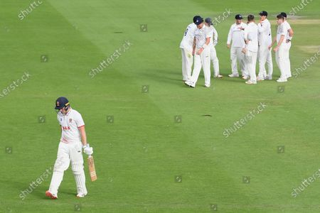 Wicket - Dan Lawrence of Essex walk off having been caught by Ben Brown  of the bowling of George Garton for 60 during the Bob Willis Trophy match between Sussex County Cricket Club and Essex County Cricket Club at the 1st Central County Ground, Hove