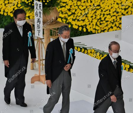 Stock Image of (L-R)Japan's Former Prime Minister Yoshihiko Noda, Yukio Hatoyama and Yasuo Fukuda offer flowers during the memorial service for the war dead of World War II marking the 75th anniversary in Tokyo, Japan.