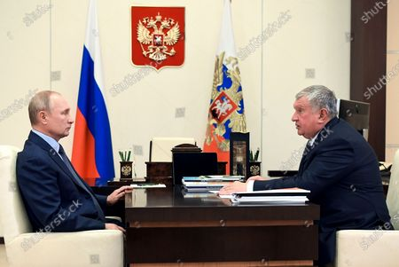 Russian CEO of Rosneft oil company Igor Sechin, right, speaks to Russian President Vladimir Putin during a meeting at the Novo-Ogaryovo residence outside Moscow, Russia