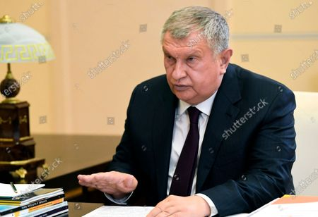 Russian CEO of Rosneft oil company Igor Sechin speaks to Russian President Vladimir Putin during a meeting at the Novo-Ogaryovo residence outside Moscow, Russia