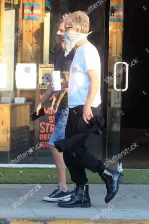 Stock Picture of Andy Dick walks along the street