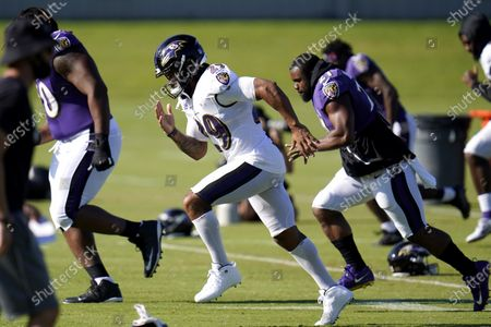 Stock Picture of Baltimore Ravens safety Earl Thomas III, center, works out with teammates during an NFL football camp practice, in Owings Mills, Md