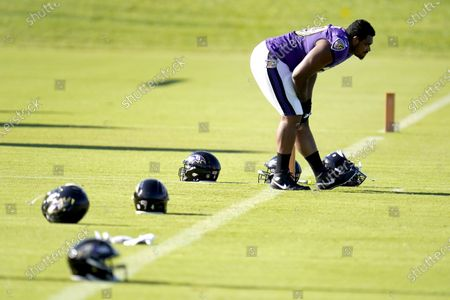 Baltimore Ravens offensive tackle Ronnie Stanley stretches during an NFL football camp practice, in Owings Mills, Md