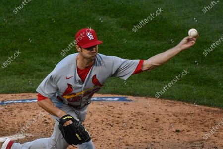 St. Louis Cardinals relief pitcher Andrew Miller (21) delivers during the seventh inning of Game 1 of a baseball doubleheader against the Chicago Cubs, in Chicago