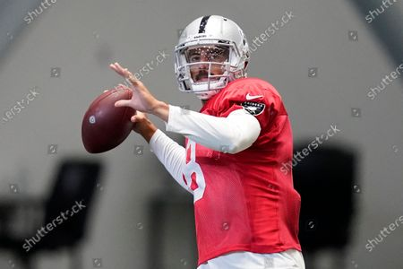 Las Vegas Raiders quarterback Marcus Mariota (8) drops back for a pass during an NFL football training camp practice, in Henderson, Nev