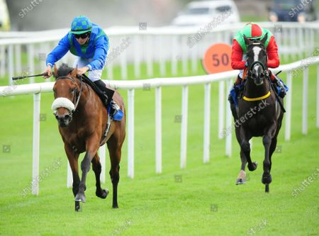 Stock Picture of ROSCOMMON SNAPRAETEREA and Dylan Brown McMonagle win the Foran Equine Irish EBF Auction Race from Elysium (right). Healy Racing