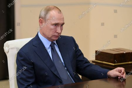 Russian President Vladimir Putin during a meeting with Igor Sechin (not pictured) Chief Executive of Rosneft at Novo-Ogaryovo state residence, outside Moscow, Russia, 18 August 2020.