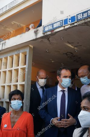 Stock Photo of Sebastien Lecornu, Minister of Overseas France, meets residents of social housing in Saint-Denis in the company of the mayor Ericka Bareigts.