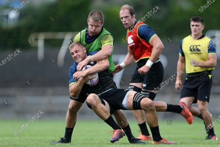James King is tackled by Olly Cracknell during training.