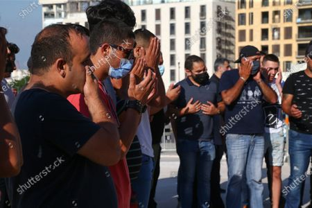 Supporters of the martyr former Prime Minister Rafic Hariri mourn during gathering as They recite Al-Fatiha next to his grave as they listen to former prime minister Saad harir delivering a speesh from Leidschendam, Netherlands, in downtown Beirut, Lebanon, 18 August 2020. Judges of the UN-backed Special Tribunal for Lebanon in the Netherlands found Salim Ayyash, a member of the Hezbollah militant group, guilty of involvement in the assassination of former Lebanese Prime Minister Rafic Hariri and 21 others on 14 February 2005.