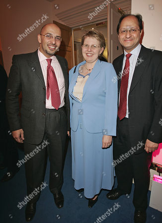 Conservative Party Policy Unit Christmas Drinks Party L-r Nadhim Zahawi Beverley Uara Shailesh Vara.