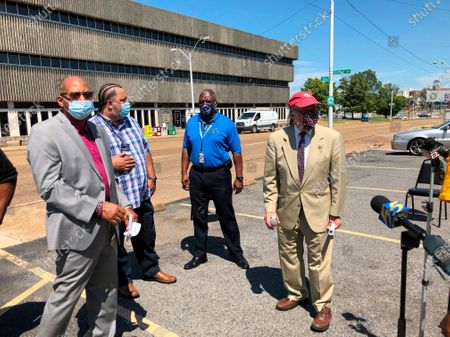 Rep. Steve Cohen, right, D-Tenn., stands alongside postal worker union representatives after a news conference about problems with the U.S. Postal Service, in Memphis, Tenn