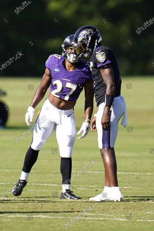 Baltimore Ravens 2020 second round draft pick running back J.K. Dobbins (27) talks with quarterback Lamar Jackson during an NFL football camp practice, in Owings Mills, Md