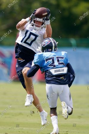 Tennessee Titans wide receiver Adam Humphries (10) makes a catch as he is defended by cornerback Chris Jackson (35) during NFL football training camp, in Nashville, Tenn